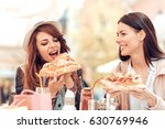 two cheerful  girls eating... | Shutterstock . vector #630769946