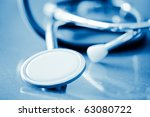 stethoscope with shallow depth of field and blue tint - stock photo
