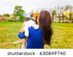 Stock photo the girl holds a dog walk 630849740