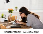 businesswoman sitting in wrong... | Shutterstock . vector #630852500