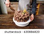 female hands cutting chocolate... | Shutterstock . vector #630886820