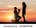 silhouette of a man proposing... | Shutterstock . vector #630888908