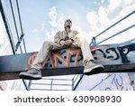 a rap singer on a concrete beam ...   Shutterstock . vector #630908930