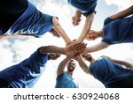 fit people with hands stacked... | Shutterstock . vector #630924068