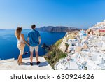 young couple  on the roof of... | Shutterstock . vector #630924626