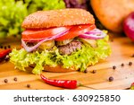 hamburger on wooden board | Shutterstock . vector #630925850