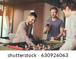 friends having fun in pub | Shutterstock . vector #630926063