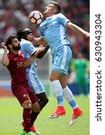 Small photo of 30.04.2017. Stadio Olimpico, Rome, Italy. Serie A. Roma versus Lazio. Milinkovic and Salah in action during the match Serie A in olimpic stadium in Rome.