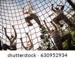 military soldiers climbing rope ... | Shutterstock . vector #630952934