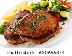 grilled beefsteak with french... | Shutterstock . vector #630966374