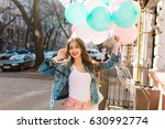 charming smiling girl in denim... | Shutterstock . vector #630992774