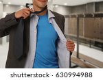 young businessman taking off... | Shutterstock . vector #630994988
