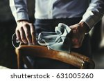restaurant staff wiping glass...   Shutterstock . vector #631005260