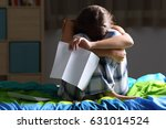front view of a single sad teen ... | Shutterstock . vector #631014524