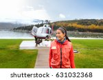 happy helicopter tourist woman... | Shutterstock . vector #631032368