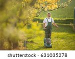 senior man mowing the lawn in... | Shutterstock . vector #631035278