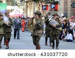 Small photo of BRISBANE, AUSTRALIA - APRIL 25, 2017: Army band members dressed in World War 2 uniforms while performing in the ANZAC parade.