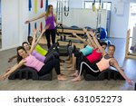 female trainer assisting group... | Shutterstock . vector #631052273