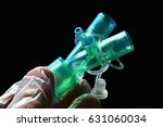 Small photo of Plastic ypsilon piece of airway management tubes connection with opened additional ports held in doctor lef hand in glove on dark background