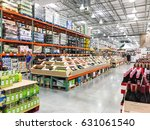 Small photo of HUMBLE, TEXAS,US-APR 15, 2017:Aisle of bottles in wine section of Costco store. This largest wholesale membership-only warehouse club in United States known for its low-price offers. Customer shopping