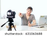 a young handsome blogger sits... | Shutterstock . vector #631063688