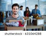 portrait of smiling man holding ... | Shutterstock . vector #631064288