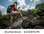 young woman hiker standing on... | Shutterstock . vector #631069244