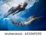 underwater shot of the couple... | Shutterstock . vector #631069250