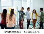 creative business team looking... | Shutterstock . vector #631083278