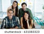 portrait of smiling creative... | Shutterstock . vector #631083323