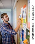 man writing on the sticky note... | Shutterstock . vector #631086314