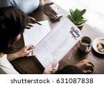 hands holding wedding planner... | Shutterstock . vector #631087838