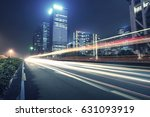 the traffic light trails of city | Shutterstock . vector #631093919