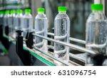 conveyor with water bottles | Shutterstock . vector #631096754