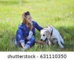 beautiful blonde girl is...   Shutterstock . vector #631110350