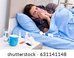 sick ill man in the bed taking... | Shutterstock . vector #631141148