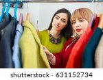 girl with stylist choosing her... | Shutterstock . vector #631152734