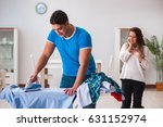 man husband ironing at home... | Shutterstock . vector #631152974