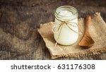 yogurt in glass bottles on old... | Shutterstock . vector #631176308