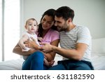 couple playing with their baby... | Shutterstock . vector #631182590