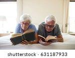 senior couple reading books on... | Shutterstock . vector #631187933