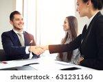 business people shaking hands ... | Shutterstock . vector #631231160