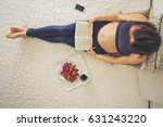 young pregnant woman  lying in... | Shutterstock . vector #631243220