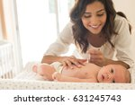 young mother moisturizing baby... | Shutterstock . vector #631245743