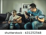 father teaching his son to play ... | Shutterstock . vector #631252568