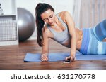 slim fitness young woman doing...   Shutterstock . vector #631270778