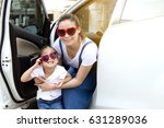 asian mother and daughter... | Shutterstock . vector #631289036