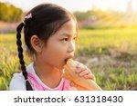little girl girl eating ice... | Shutterstock . vector #631318430