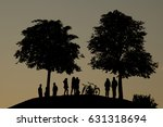 silhouettes of peoples and trees | Shutterstock . vector #631318694