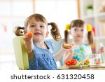 happy kids eating healthy food... | Shutterstock . vector #631320458